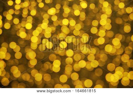 Abstract backgroung of golden glitter and glow soft bokeh shining light. Dreamy sparkle background