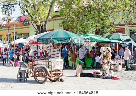 OAXACA, OAXACA, MEXICO - DECEMBER 26, 2016: Vendors at tourist walkway in a sunny day in Oaxaca,  Mexico