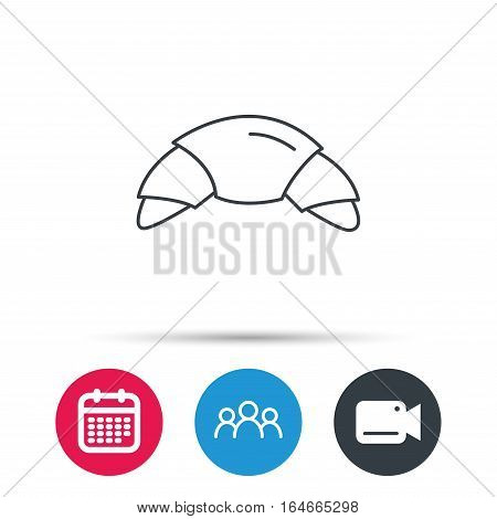 Croissant icon. Bread bun sign. Traditional french bakery symbol. Group of people, video cam and calendar icons. Vector