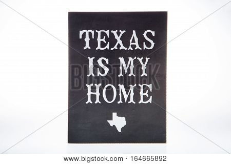 A novelty sign about Texas against a white background