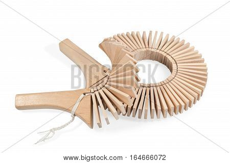 Wooden ethnic musical instruments - ratchet of the plates with two handles, isolated on a white background