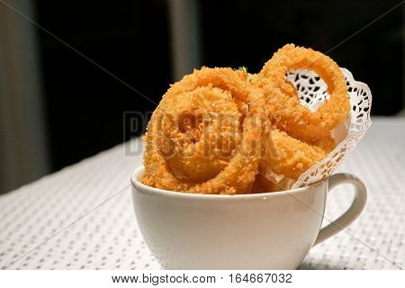 Fried onion rings crisp in a white cup plate deep fried