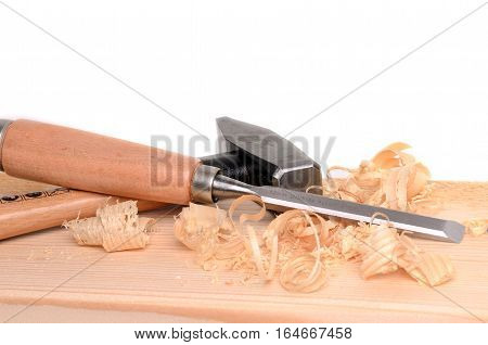 Carpenter tools hammer and chisel on white background