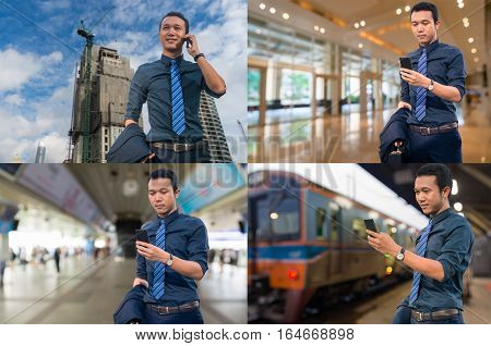Asian Businessman use Mobile Smartphone at Construction site Office Building Train Station or Railway Station Subway or Mass Transite Station as Business Technology Concept.