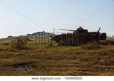 Ukrainian armored vehicles destroyed in the July fighting near the memorial at the top of the Saur-Graves
