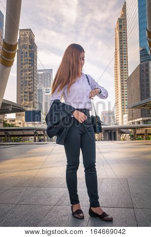 Young Business Woman Looking Watch As Waiting Appointment