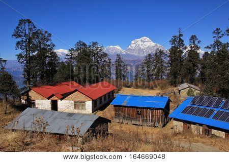 Lodges on top of Mohare Danda. View of mount Dhaulagiri.