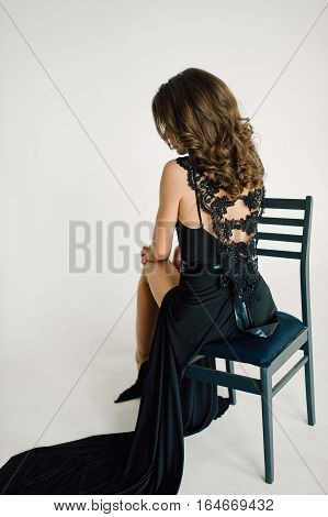 Individuality. Thoughtful Elegant Lady In Black Prom Evening Dress. Studio Retouched Photo.