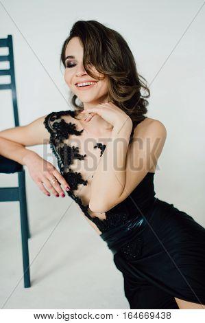 Individuality. Thoughtful Elegant Lady In Black Prom Evening Dress. Studio Retouched Photo.