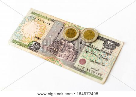 20 Egyptian pounds old banknote denominations of twenty EGP with mosque. Coin 1 pound with Sphinx. Symbol of Egypt currency to wealth and investment. Eastern Muslim culture ornament and writing