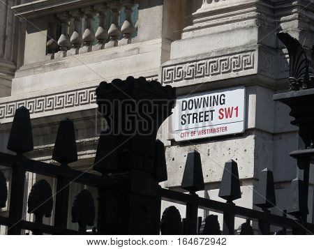 A well angled shot portraying the world famous Downing street sign in westminster.