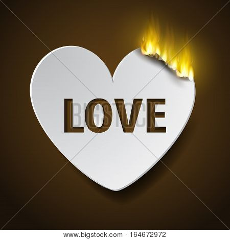 burning paper hear for Valentines day with fire and word LOVE