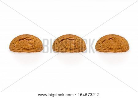 Three pepernoot a typical dutch treat for Sinterklaas on 5 december. Cookies isolated on white background front view.