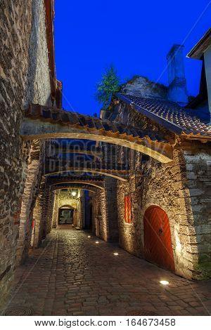 Medieval Street - Saint Catherine Passage At Night In Tallinn, Estonia.