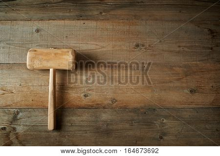 Top view mallet on an old wooden workbench