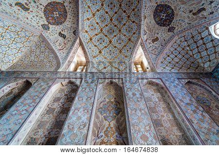 Isfahan Iran - October 20 2016: Ceiling paintings of Ali Qapu palace in Isfahan city Iran
