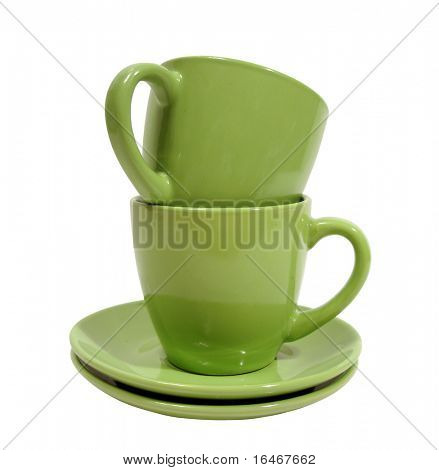 two green cups with saucer over white background