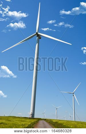 Wind energy turbine on a blue sky background