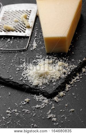 Parmesan Cheese With A Grater.cocnept Proces With Food . Grater Cheese.selective Focus