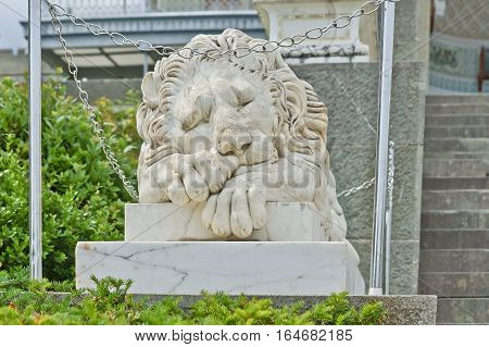 ALUPKA RUSSIA - MAY 30 2014: Statue of lion at the Vorontsov Palace facade in the resort town of Alupka. This palace is a tourist attraction of the Crimea.