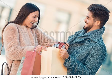 Young happy couple with shopping bags in the cityhaving fun.