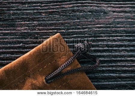Combined background of colden suede and dark wood. Macro view