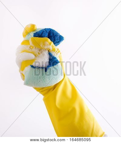 Hand With Gloves Squeezing Sponge