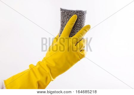 Hand With Gloves Holding Scrubber Sponge