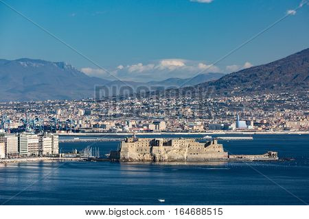 Aerial view of the famous seaside castle in Naples located on the former island of Megaride now a peninsula on the Gulf of Naples in Italy.