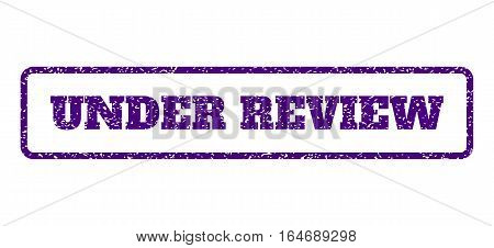 Indigo Blue rubber seal stamp with Under Review text. Vector message inside rounded rectangular frame. Grunge design and scratched texture for watermark labels.