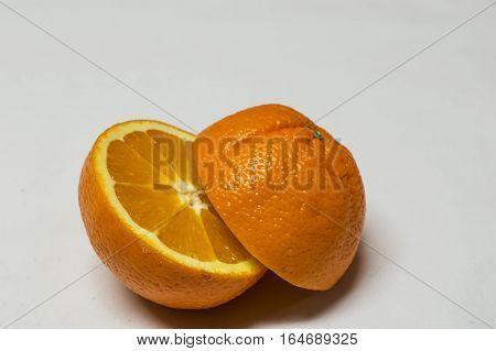 Healty food. Orange cut on a half isolated on white background. Orange ready to wringing -squeezing.