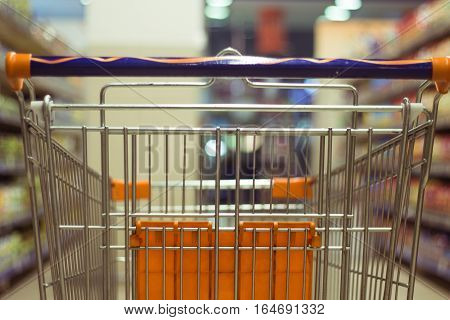 Abstract blurred photo of shopping cart/trolley in the shop