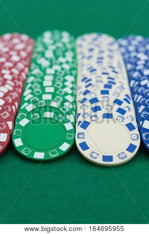 lots of poker chips on casino table vertical