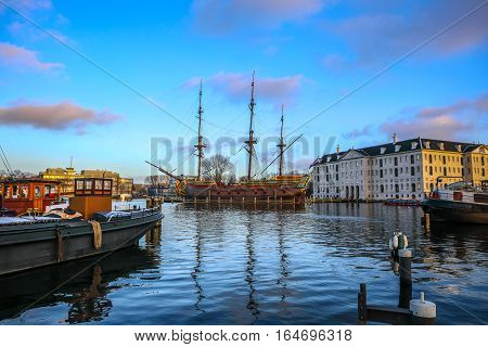 AMSTERDAM NETHERLANDS - JANUARY 02 2017: Boats on water in beautiful evening sun set. January 02 2017 in Amsterdam - Netherland.