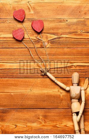 Gestalta Or Poppet Toy Holding Hearts