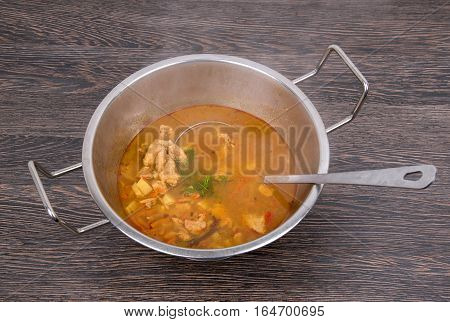 Traditional hungarian dish hot goulash with potatoes