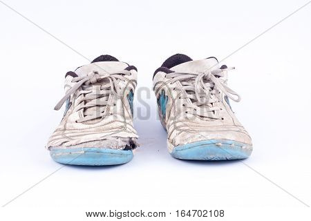 Old retro blue damaged futsal sports shoes  on white background  isolated ( front view )