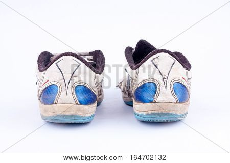 Old retro worn out futsal sports shoes  on white background  isolated ( back view )