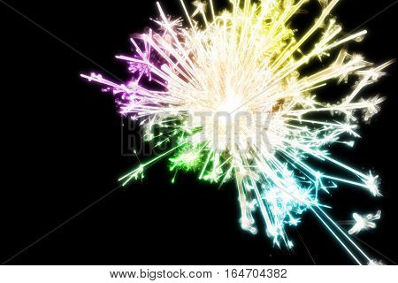 Abstract scene of the colorful firework sparking light with the dark background