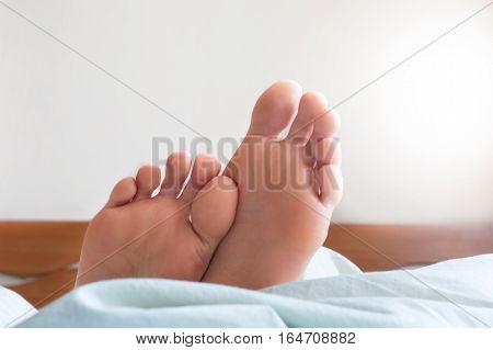 Healthy female feet. Bright morning. White background
