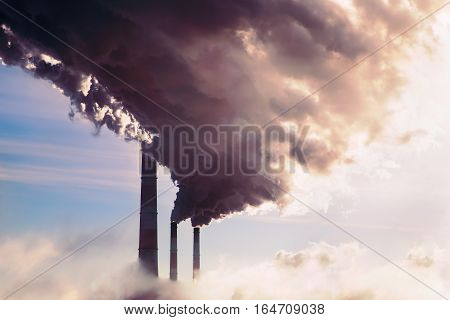 Smoking chimney of industrial buildings complex. high pollution from coal power plant