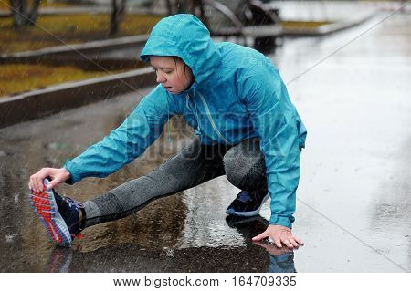 Running Stretching. Runner Woman Stretching Leg As Warm-up Before Run.