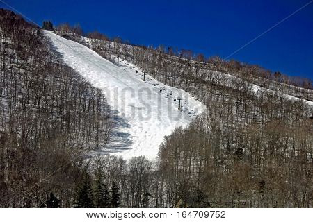 A ski and lift in the winter