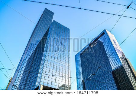 ROTTERDAM NETHERLANDS - DECEMBER 27 2016: Modern buildings of business center close-up modern architecture. December 272016 in Rotterdam - Netherlands.