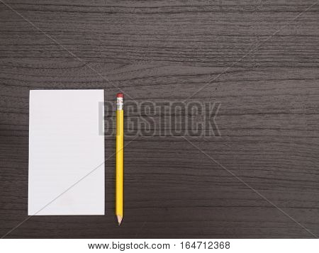 Dark Wood Desktop Surface White Notepad With Pencil