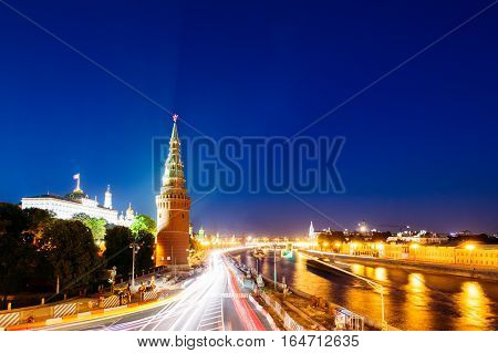 City landscape with Vodovzvodnaya Tower of the Kremlin in the evening. Government House in the background. Blue sky