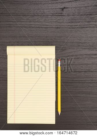 Darl Wood Desk Surface Yellow Notepad Pencil