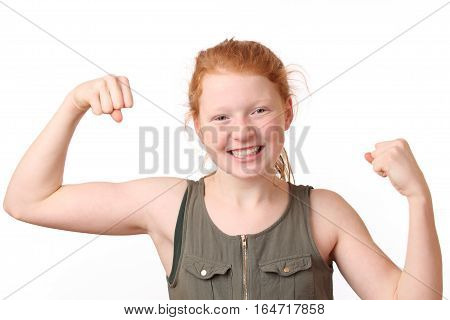 Portrait of a winning young girl flexing muscles on white background