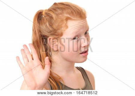 Portrait of a teenage girl showing stop gesture with hand on white background
