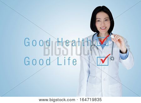 Medical physician doctor woman over blue background. Good health Good life